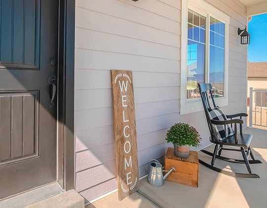 Homeowners insurance in Abingdon, VA, home porch with welcome sign