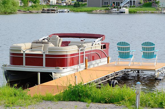 Boat and auto insurance in Chilhowie for watercraft on lake by small dock