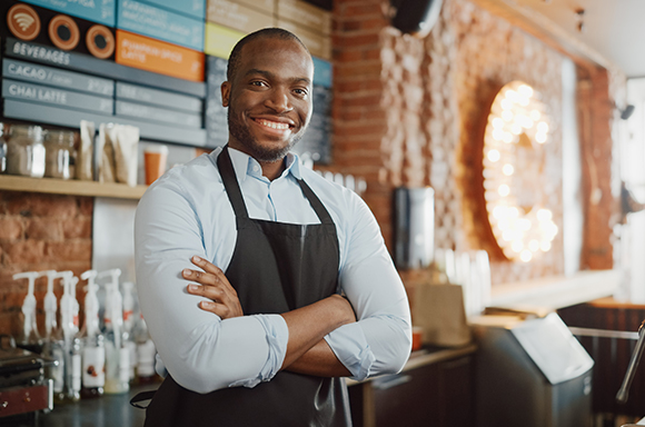 small business insurance in Bristol, VA with smiling business owner in cafe